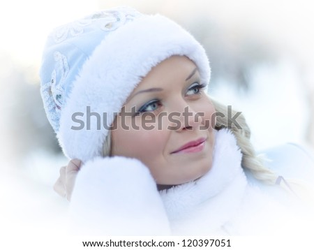 smiling girl dressed in traditional russian christmas costume of Snegurochka (Snow Maiden)