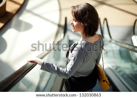 Smiling girl in  a shopping center