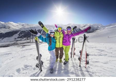 Smiling girl in blue jacket skiing alps resort