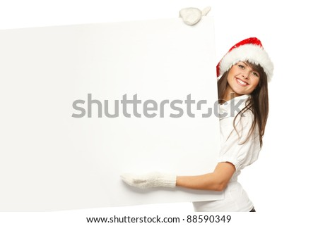 Smiling girl in Santa hat holding blank banner, isolated on white background