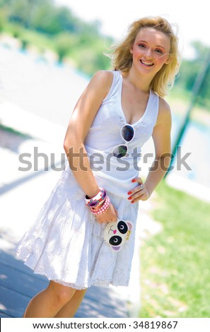 smiling girl in summer dress with cool wallet