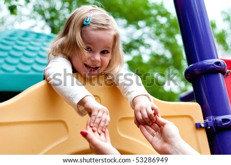 Smiling girl in the playground . Outdoor shot