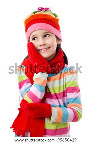 Smiling girl in winter clothes, isolated on white