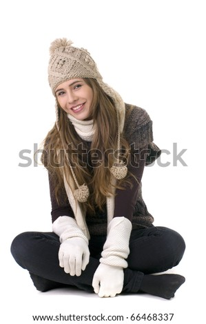 Smiling girl in winter style on a white background