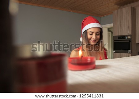 smiling girl is preparing a sweets for Christmas