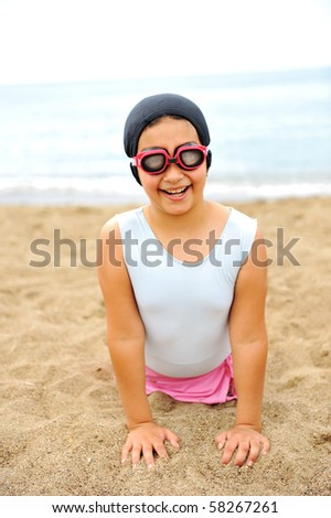 Smiling girl on beach