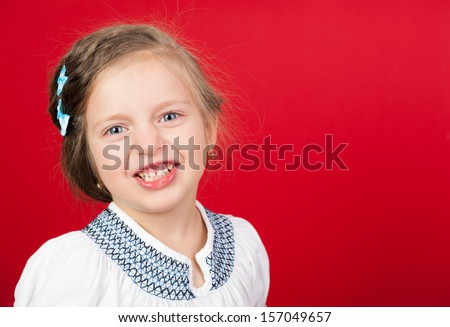 smiling girl portrait on red