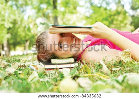 smiling girl reading ridiculous book