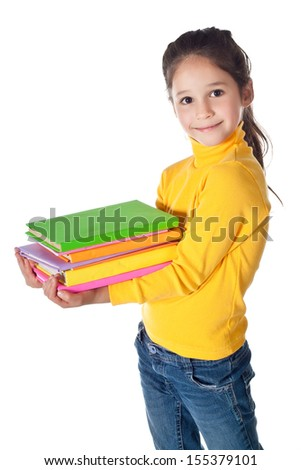 Smiling girl standing with colorful stack of books in hands, isolated on white
