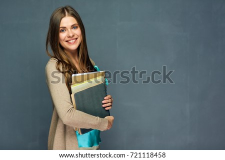 Smiling girl student or woman teacher portrait on gray wall. #721118458