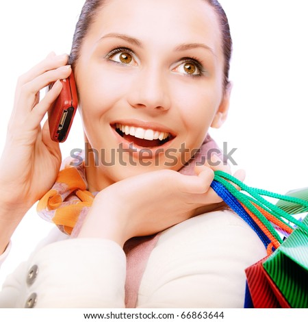 Smiling girl to call by phone close up, having control over purchases, on white background.