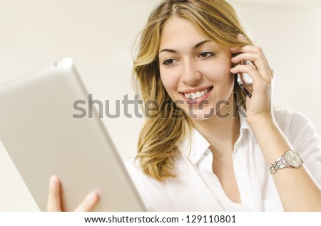 smiling girl using phone and tablet