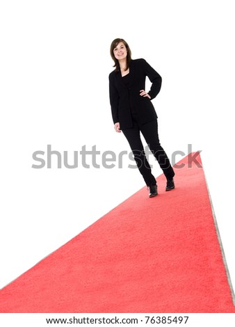 Smiling girl walking on red carpet isolated on white