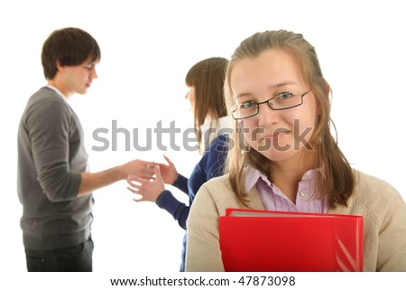 smiling girl with a  book and blur peoples background