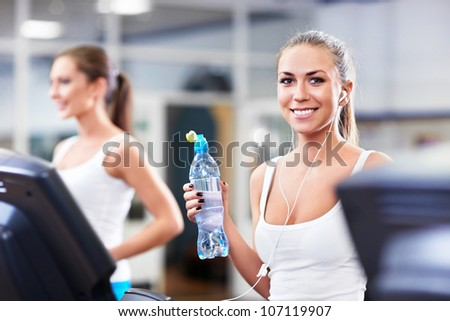 Smiling girl with a bottle of water