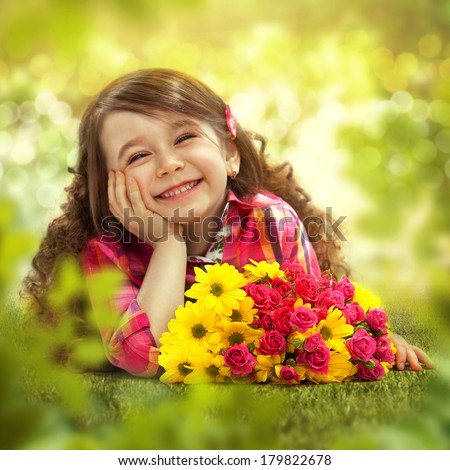 Smiling girl with big bouquet of flowers lying on grass. Spring, Mothers day, family holiday, Happiness concept.