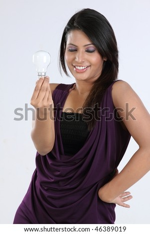 Smiling girl with bulb