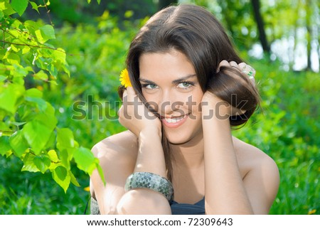 Smiling girl with dandelion