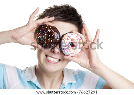 Smiling girl with donuts as eyes isolated on white