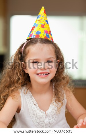 Smiling girl with party hat