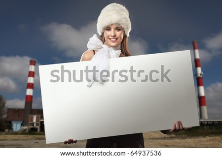 Smiling girl with white board - stock photo