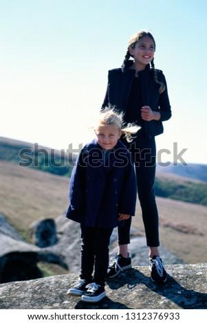 Smiling Girls on Large Rocks #1312376933