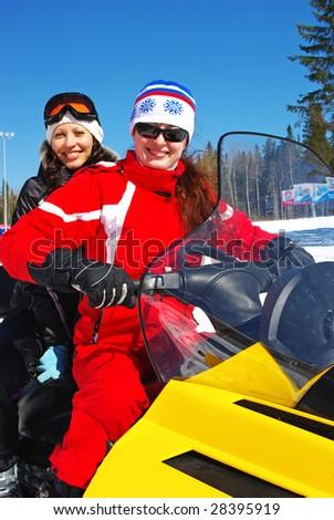 smiling girls on snow car