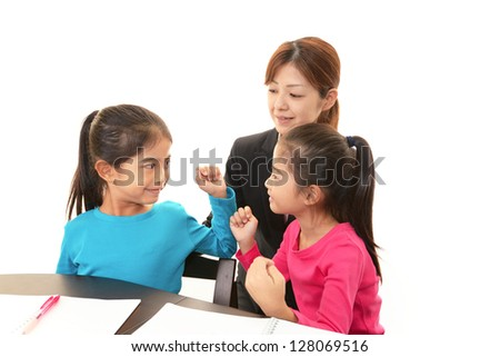 Smiling girls with teacher