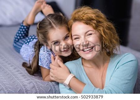 Smiling granddaughter having fun her grandmother #502933879