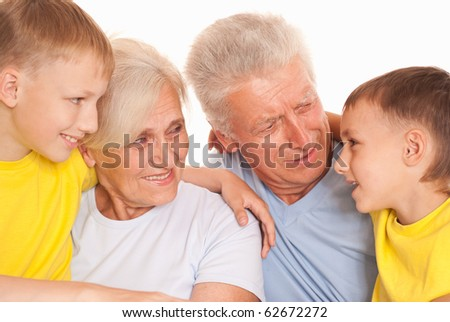 smiling grandparents with garng childrens on a white background