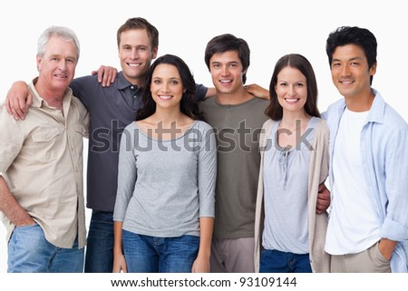 Smiling group of friends against a white background