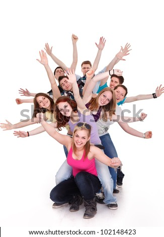Smiling group of young friends having fun with outstretched arms