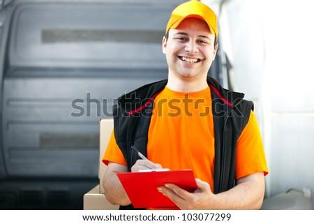 Smiling guy delivering a parcel