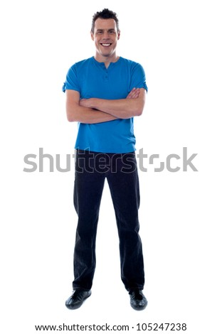Smiling guy with crossed arms looking at camera