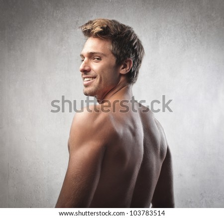 Smiling handsome brawny young man
