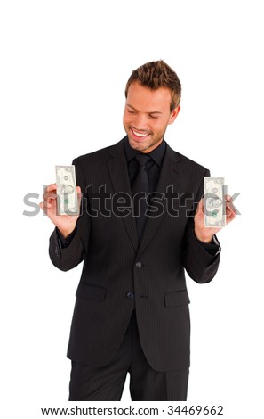 Smiling handsome businessman looking at dollars