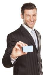 smiling handsome businessman showing a credit card
