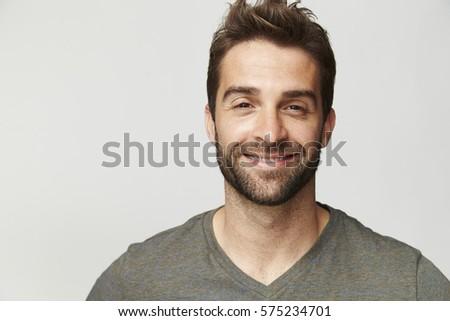 Smiling handsome dude in grey, portrait