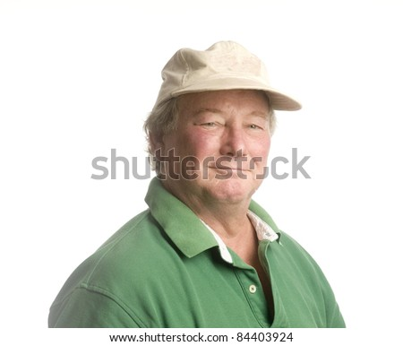 smiling handsome happy middle age senior man wearing casual hat and green polo shirt - stock photo