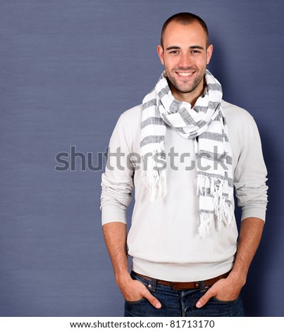 Smiling handsome man wearing scarf