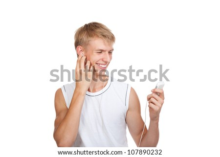 Smiling handsome young guy listening to music songs on the mp3 player, man wear white t shirt isolated over white background