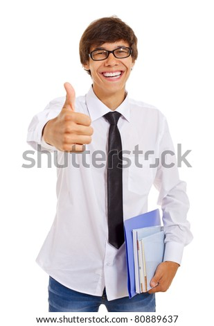 Smiling handsome young man holding books and showing thumb up over isolated background. Mask included