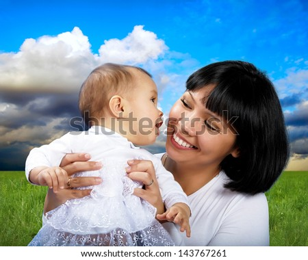 Smiling happiness mother with child, outdoor