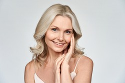 Smiling happy attractive 50s middle aged blonde woman, older lady looking at camera advertising anti age face skin and body care treatment cosmetics isolated on white background. Close up portrait.