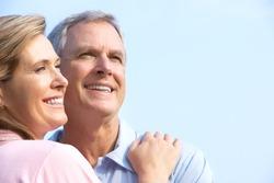 Smiling happy  elderly couple in summer park