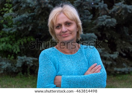 Smiling happy ellderly woman stands with crossed arms Zdjęcia stock ©