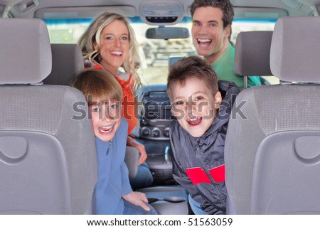 Smiling happy family in the car