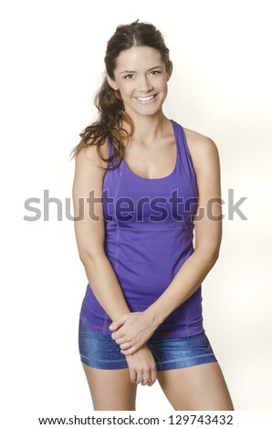 Smiling happy fitness young woman