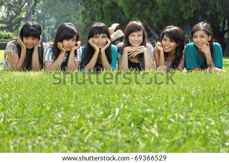 Smiling Happy group of girl friends in the park