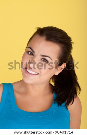 Smiling Happy Healthy Woman isolated on yellow studio background